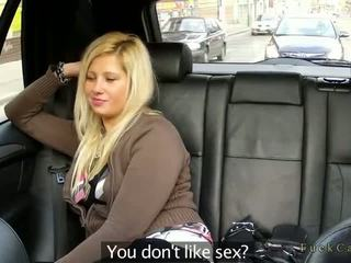 Chubby blonde fucking in fake taxi in public