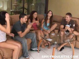 Junior females having funtime striptease poker