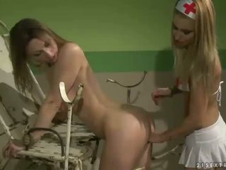 Young nurse punishing slavegirl