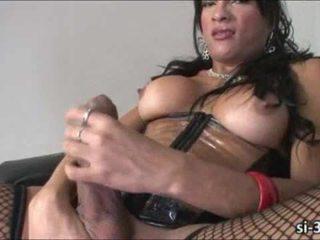 Nasty tgirl Jo Garcia strokes her cock until it shoots sperm