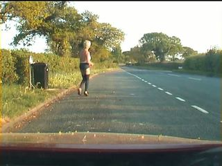 Mature shemale walking on a road