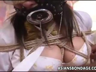 Asian bitch with a mouth piece gets abused a bit
