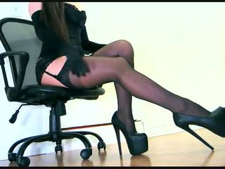 Sensual teasing in a corset and layered hosiery