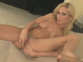 Blonde babe Hillary Scott shoves her tight pussy with dildo toy