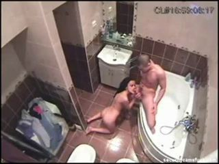 Amateur couple caught by security cam fuck in bathroom