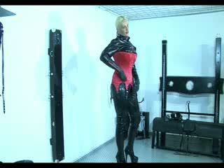 Delicious slave girl in latex and high heels showing off her curves
