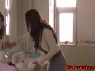 Japanese mature MILF masturbates in a bath