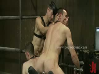 Sexy gay males bound and whipped in rough spanking and bondage sex with dirty masters
