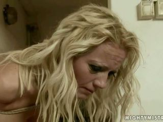 Young mistress punishing mature blonde