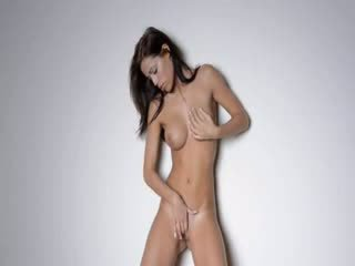 Sexy slim brunette touching her pussy