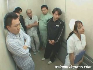 Petite Japanese nurse in elevator abuse