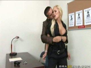 Busty Blonde Policewoman spreads legs