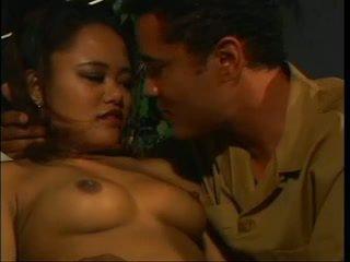 Lusty asian Annie licks a big dickknob on couch