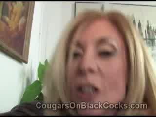 Astonishing Blond cougar prostitute Nina Hartley gets fucked by big ebony man