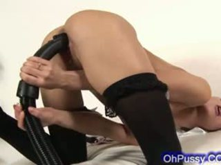 Sexy Brunette Useing A Vacuum