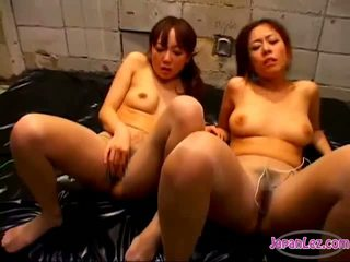 2 Asian Girls In Panthose Masturbating With Vibrators Pinching Nipples On The Mattress In The Basement