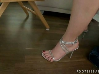 Hot blonde giving footjob and getting fucked