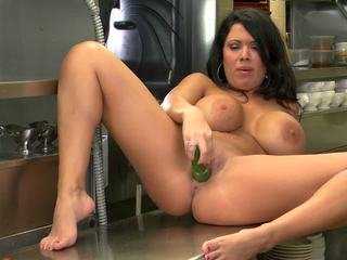 Green cucumber visits appetizing MILF's hole before a cock.
