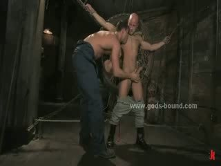 Strong master dressed in leather with his butt Naked spanking sex slave