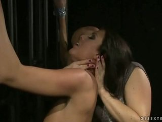 Mature mistress playing with her young slavegirl