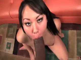 Asian Tina Lee takes a huge black Cock from behind