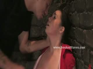 dark haired is flogged into submission and has her mouth fucked while wearing a mouth stretcher