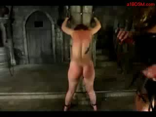 Redhead Girl Tied To Pillar Spanked Whipped Licking Mistresstrix Boots In The Dungeon