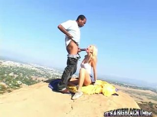 Breasty Golden Haired Kelly Wells Blows A Large Blackzilla Outdoor