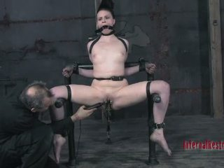 Tough beauty in shackles gets her pussy pumped