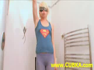 Blond supergirl painting body on toilet