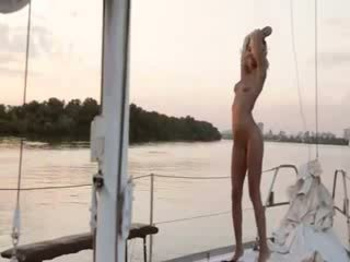 Beautiful blonde babe posing on boat