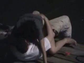 Couple fucking on pier at night