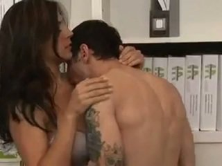 Busty Brunette secretary gives her coworker some hot pussy and fucks
