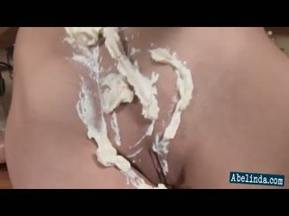 Sexy young abelinda smothers her susu and twat in cream and frigs her klitoris