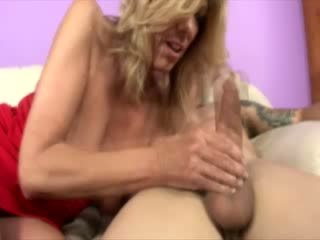 Hungry milf tugs cock for lucky guy and cant keep it from her mouth
