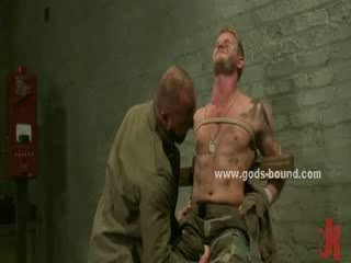 Strong chest of a homo is bound in thick rope while masters use clips to pervert him