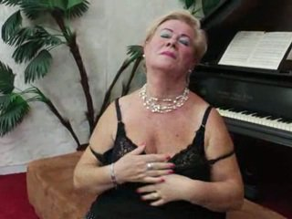 Granny playing the piano and stripping