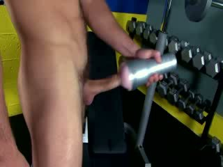 Fitness dude wanking off with toy