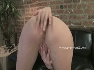 dark haired prostitute undresses and uses a bunch of bizarre vibrators up her butt while rubbing at her clit