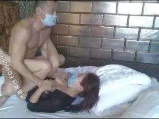 Красуня китаянка дівчина wearing маска для ебать, хороший тіло хоча
