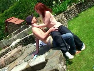 Teen posing outdoors