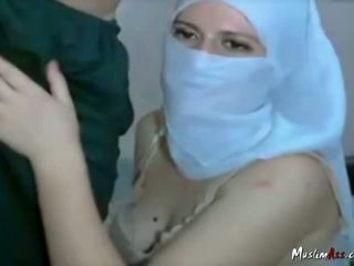 Arab woman with hijab sucking on cam