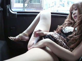 Horny cutie masturbates in the back seat of a car