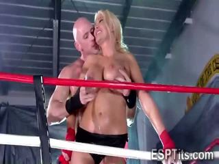 Massive tits athlete bends to get pounded in the ring