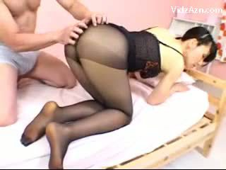 Asian Girl In Black Pantyhose Getting Her Legs And Ass Rubbed Rubbing Cock With Feet On The Bed