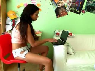 Lovely teen Kiki blowing dildo