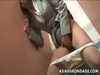 Slutty Asian nerd has a fingering session in the toilet