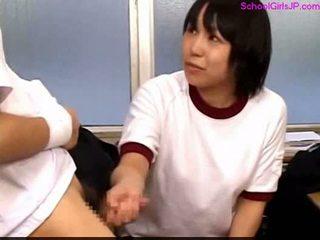 Schoolgirl in training dress giving handjob cum to floor in