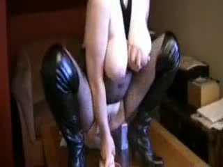 Amateur in fishnets and boots and her toy