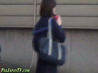 Asian schoolgirl pissing